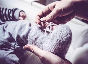 holding and dressing your baby